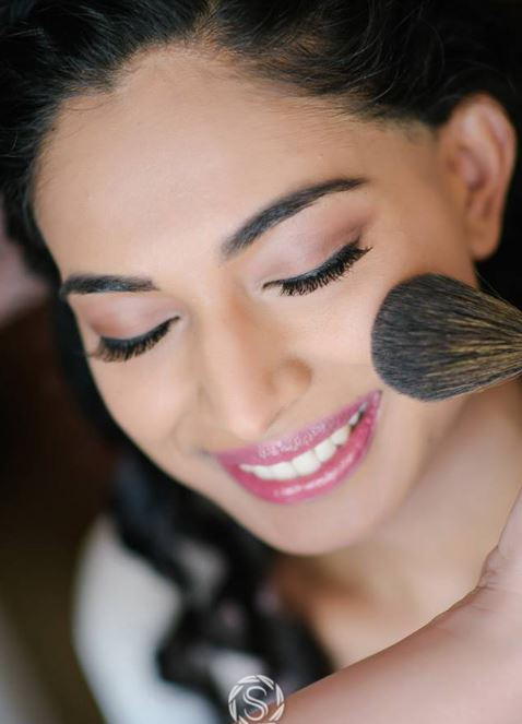 Hair and makeup with blush on natural bride